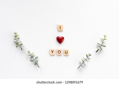I love you words on white marble background