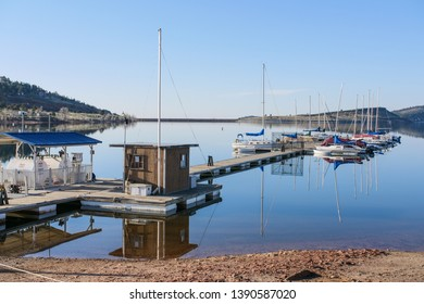 Loveland, Colorado / USA - April 27th, 2018: Side view from shore of Boat dock at carter lake