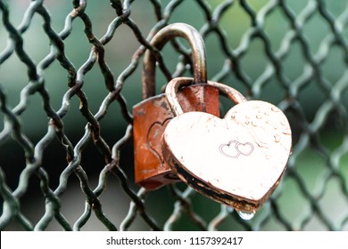 Love-locks attached to a fence Venice, Austria. Love locks are a symbol of love for young couples.