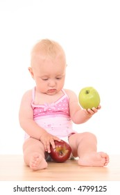 lovely 10 months baby girl with green and red apple isolated on white