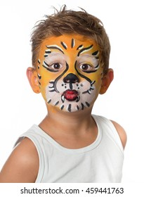 lovely adorable kid with paintings on his face as a tiger or lion