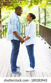 lovely african american couple holding hands outdoors