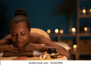 Lovely African-American woman spending her day in spa salon