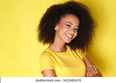Lovely afro american girl smiling to the camera.