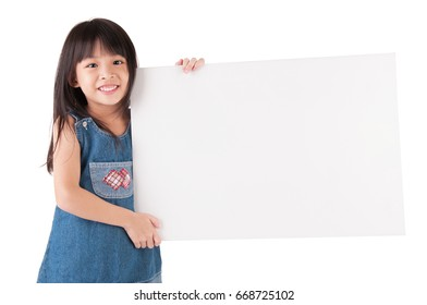 Lovely asian child holding a white board