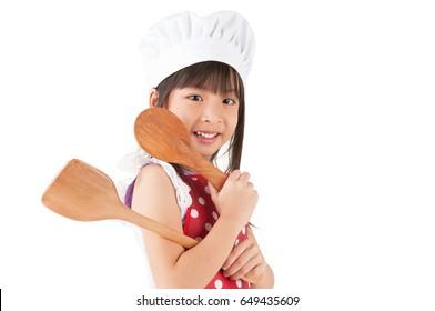 Lovely asian girl holding cooking utensils on white background