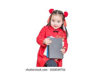 The lovely asian girl in the new year holds a book in front of the white background
