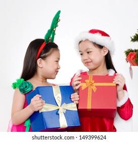 lovely asian girls holding christmas gift box