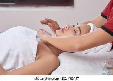 Lovely Asian young woman relaxing at spa salon