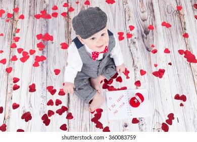 lovely baby boy in barret sitting with betrothal ring