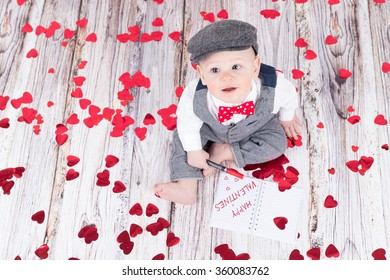 lovely baby boy in barret sitting and wishing happy valentines