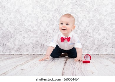Lovely baby boy smilling and pose with betrothal ring