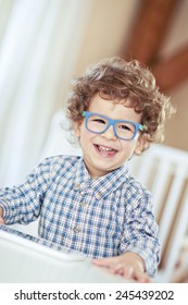 Lovely baby boy wearing glasses. Little genius, scientist
