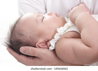 lovely baby with Dad hands  in home
