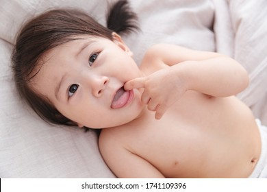 Lovely baby lying in bed