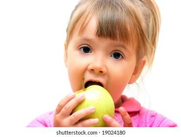 Lovely baby-girl eating fresh green apple