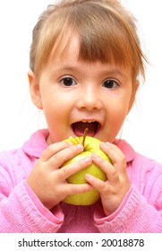 Lovely baby-girl eating green apple isolated over white