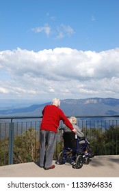 A lovely back view of an old couple at The Three Sisters Rocks at Sydney Blue Mountains Park.