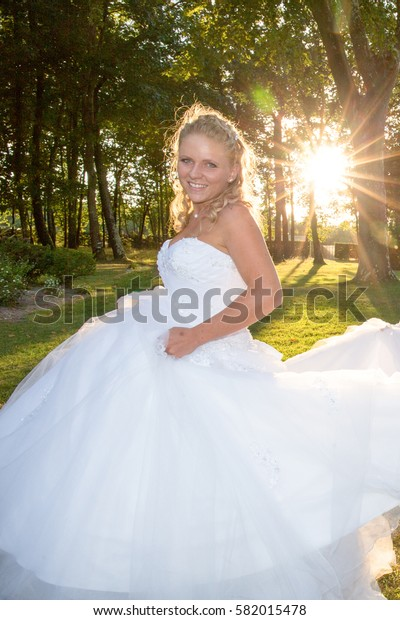 Lovely and Beautiful blond wedding bride smiling