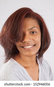 Lovely black woman looking at the camera with a friendly, smiling, expression