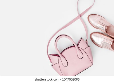 Lovely blue ladies bag and stylish golden shoes. Flat lay, top view. Spring fashion concept