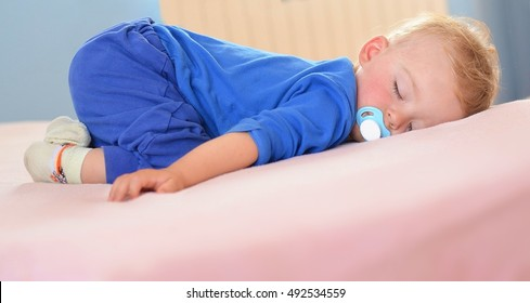 Lovely boy sleeping on his tummy during afternoon. Child concept.