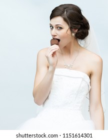 Lovely Bride Eating Ice Cream At Her Wedding