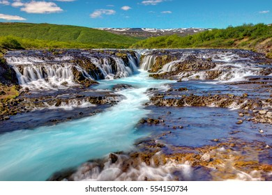 The lovely Bruarfoss waterfall in Iceland on a sunny day