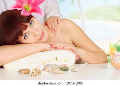 Lovely brunette doing massage at the spa