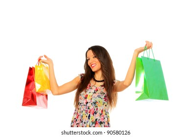 lovely brunette woman in light dress with colorful shopping bags over white