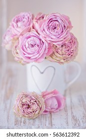 Lovely bunch of flowers .Close-up floral composition with a pink roses .Many beautiful fresh pink roses on a table.