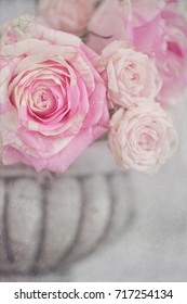 Lovely bunch of flowers .Close-up floral composition with a pink roses .Beautiful fresh pink roses on a table.