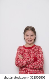 Lovely caucasian little girl wearing red christmas sweater