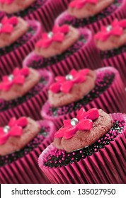 Lovely chocolate cupcakes decorated in pink