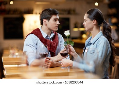 Lovely couple celebrating Valentine's Day at restaurant