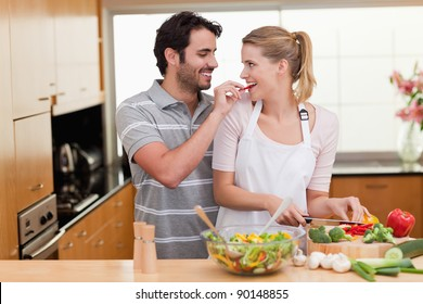 Lovely couple cooking in their kichen