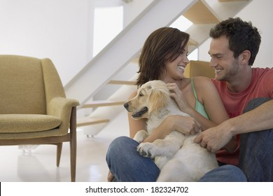 Lovely couple and dog at home