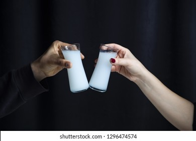Lovely Couple or Friends Sitting, Drinking, Say Cheers and drinking Turkish Traditional Drink Raki