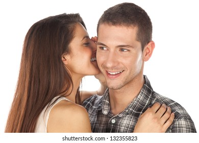 Lovely couple. Girl whispering her boy / Young love couple smiling