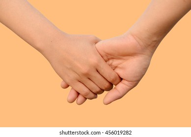 Lovely couple holding hands with pastel color background. Concept about love and relationship.