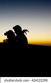 Lovely couple hug together during sunset