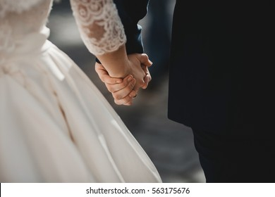 The lovely couple in love hold of hands