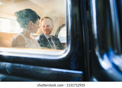 The lovely couple in love sitting in the car