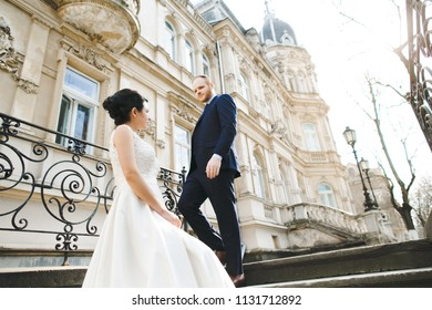 The lovely couple in love standing building