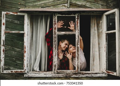 The lovely couple in love touching to window