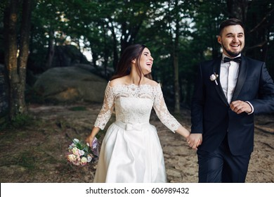 The lovely couple in love walking along forest