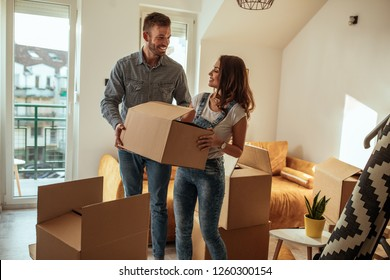 Lovely couple moving into new apartment
