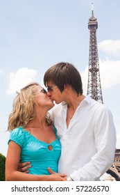 Lovely couple in Paris with Eiffel tower in background