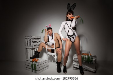 Lovely couple in rabbit costumes with carrots