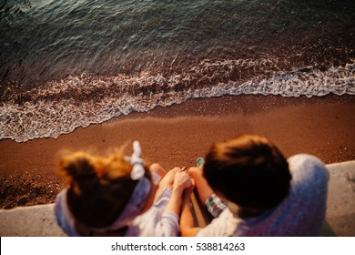 lovely couple relax on beach together. Top view
